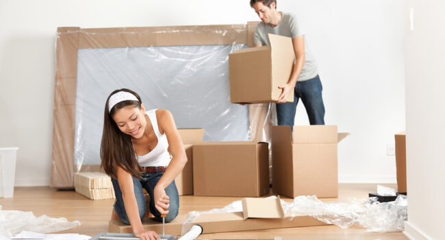 Couple organizing boxes for their move